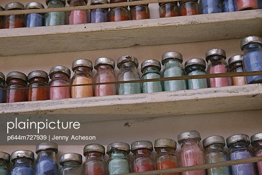 Jars Of Colored Dyes In Bottles On Shelves