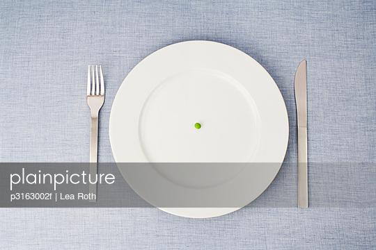 still life of single pill on plate