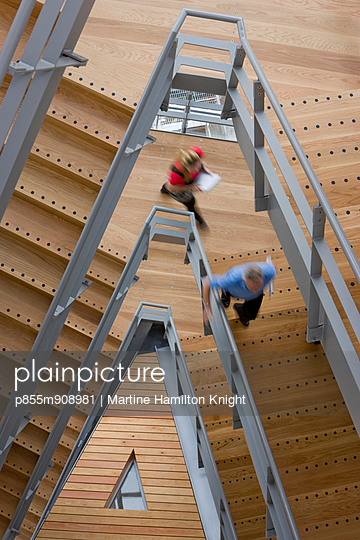 Office workers ascending a staircase, Manchester, England, UK