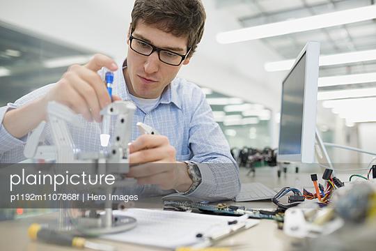 Focused engineer assembling robotics