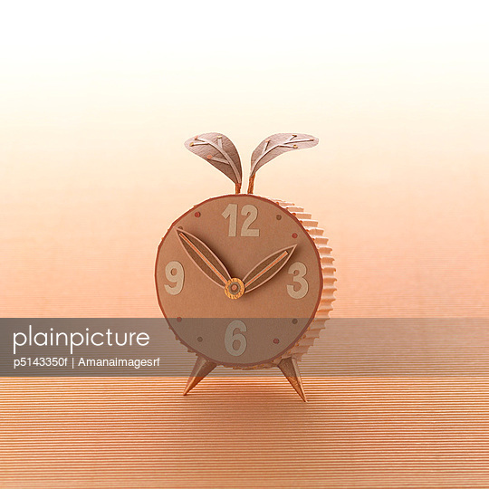 An alarm clock made out of cardboard