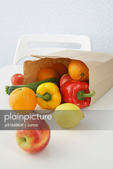 fruit and vegetables pouring out of paper bag