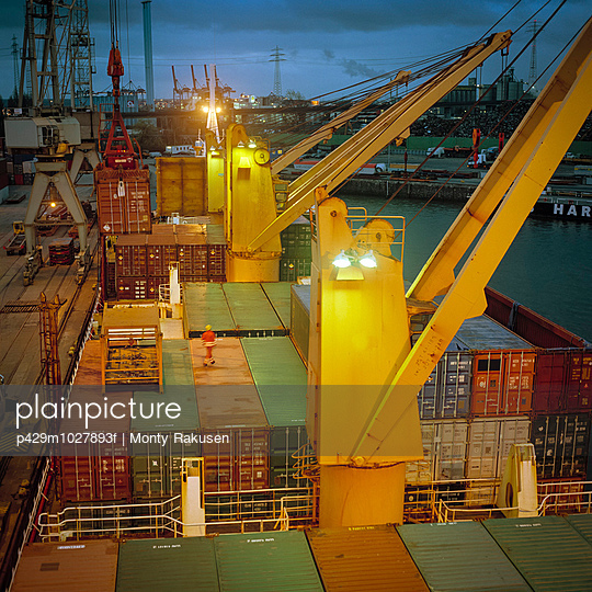 Container ship in port at night