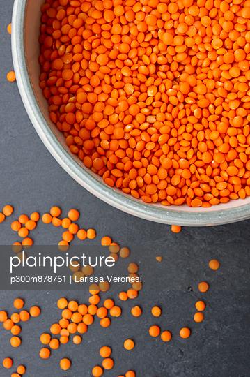 Bowl of split red lentils, close up