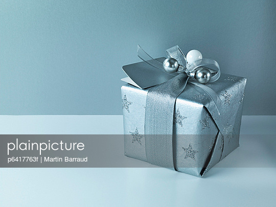 Christmas gift with silver ribbon and wrapping