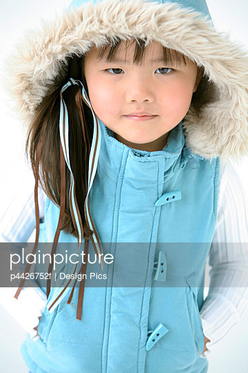 Young girl in winter clothes