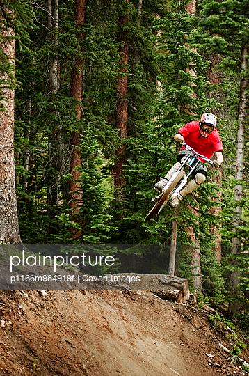 Downhill biker catching air