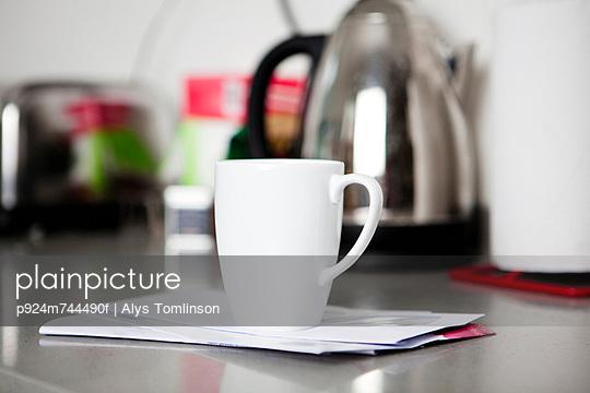 Coffee mug on top of envelopes