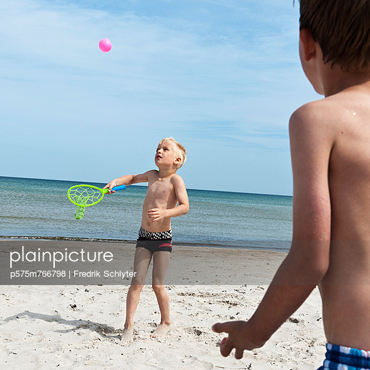 Boys playing on beach