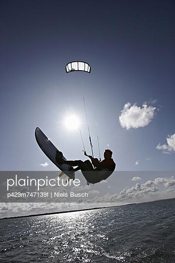Man kite surfing on calm water