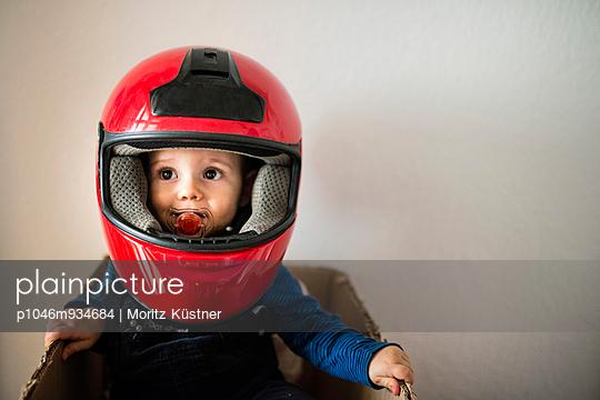 Baby wearing a helmet