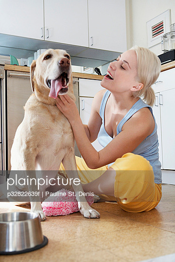 Woman sitting next to dog
