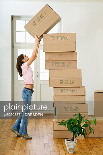 Woman stacking cardboard boxes