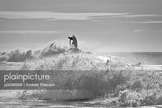 A surfer takes to the air at Sunshine Beach, Queensland, Australia
