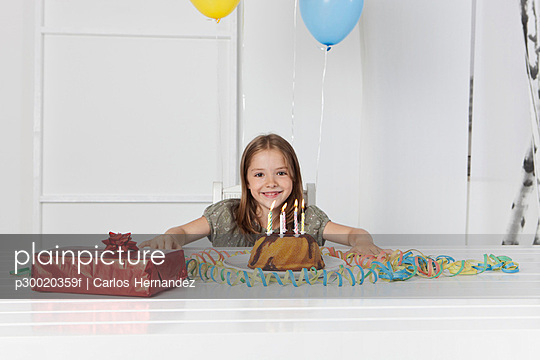 Girl with birthday cake and gift