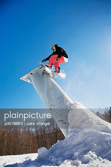 A snowboarder mid-air, Stratton, Vermont, USA