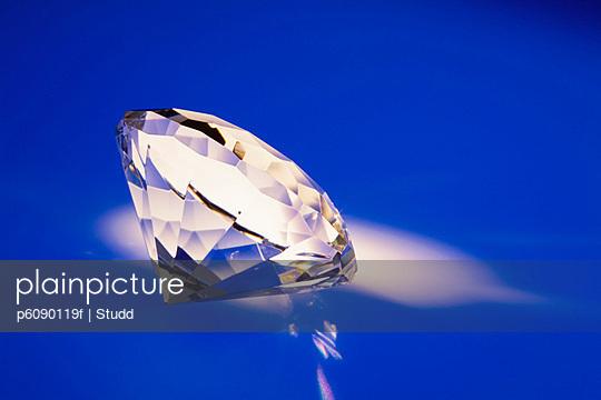 Single diamond on blue background