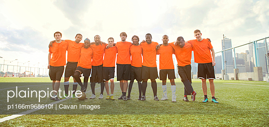 Soccer Team Standing Together on a Soccer Field