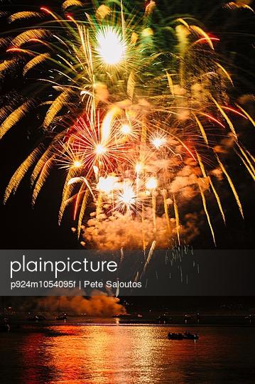 Fireworks exploding over water, Bainbridge Island, Washington, USA