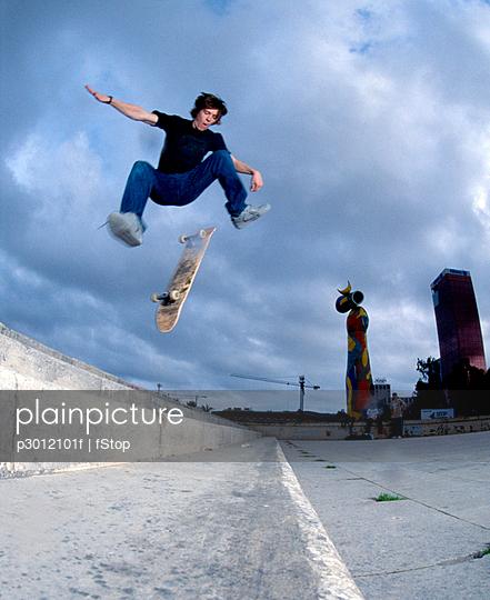 Man falling off skateboard in air