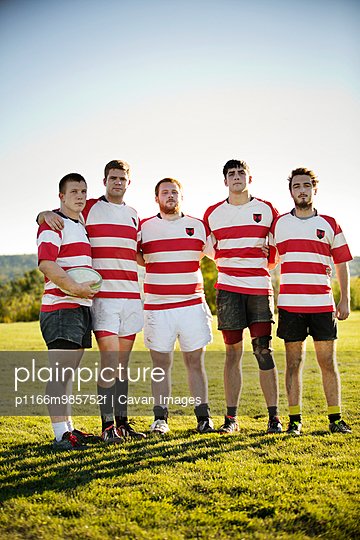 Rugby Team Standing with Arms Around Each Other