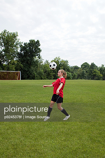 Girl soccer player with ball
