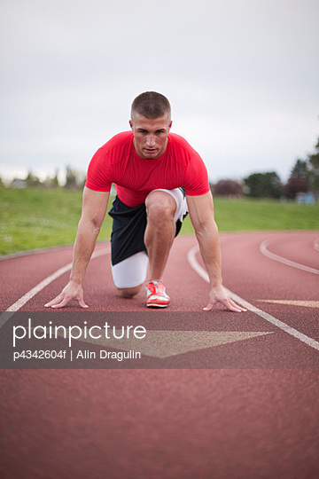 Male sprinter in set position