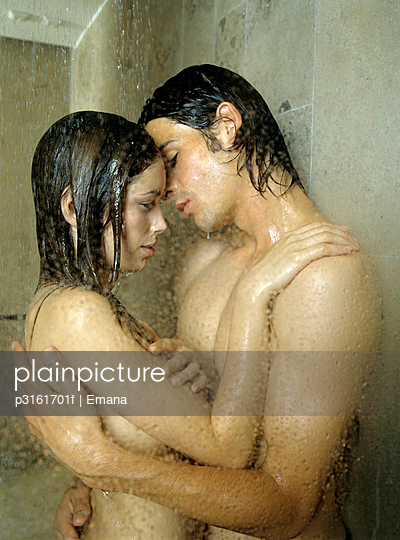 young couple about to kiss in the shower