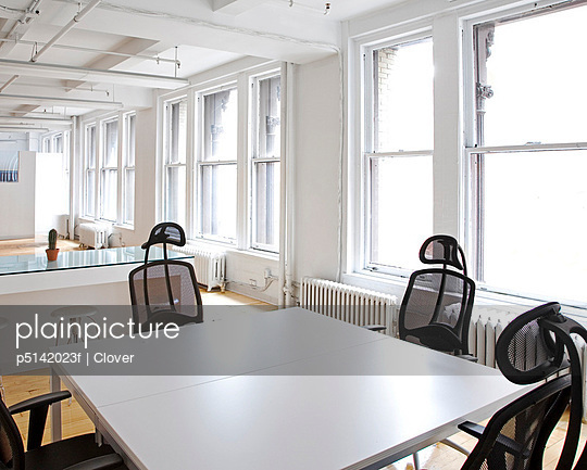 Empty Table and Chairs in Office