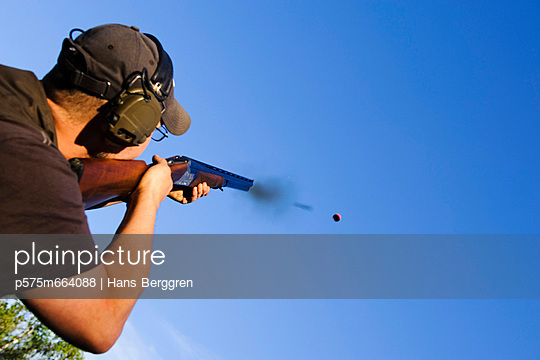 Man shooting with rifle, close-up