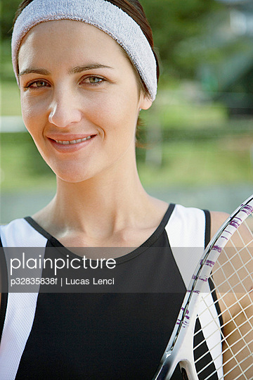 Woman holding tennis racquets
