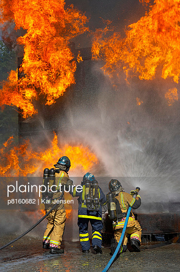 Firemen fighting wall of flames