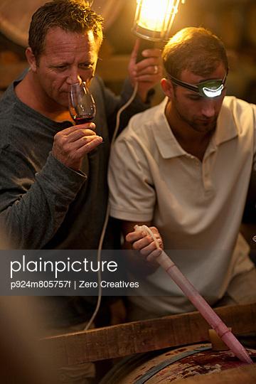 Sampling wine in barrels
