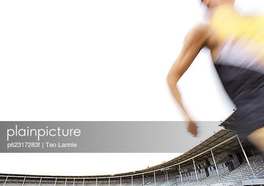 Male athlete running fast