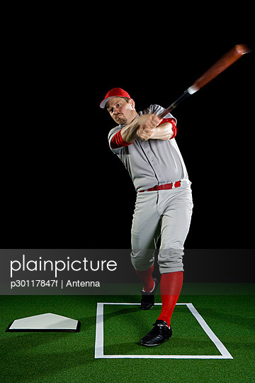 A baseball player swinging a bat
