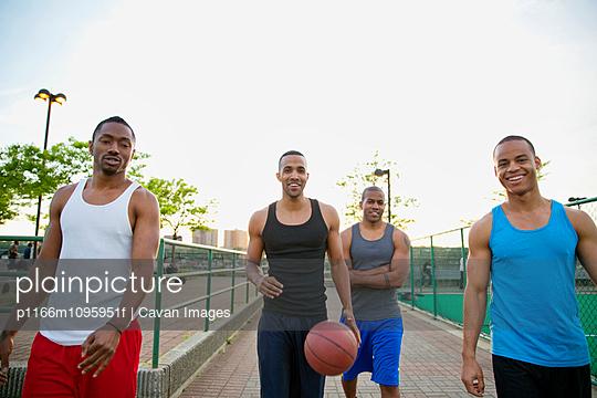 Male basketball players walking towards camera