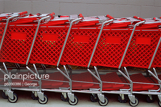Row of red shopping trolleys, Los Angeles, California, USA
