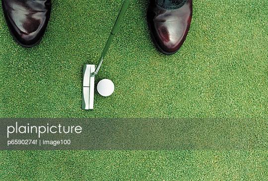 Golfer Putting the Ball