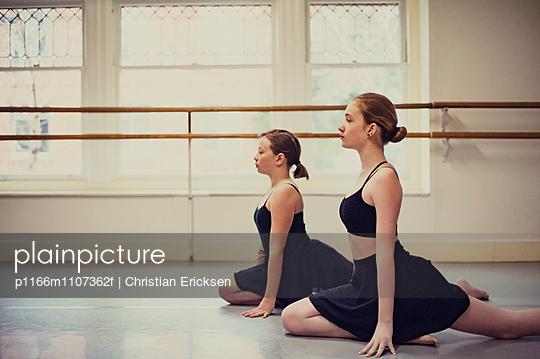 Dancers practicing ballet at dance studio