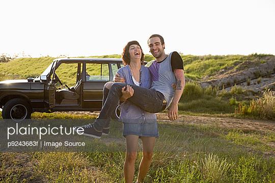 Woman carrying boyfriend