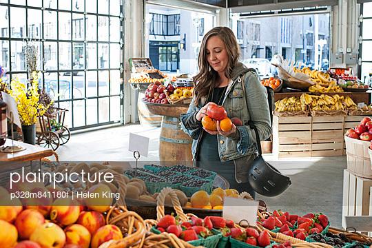 Customer selects fresh produce