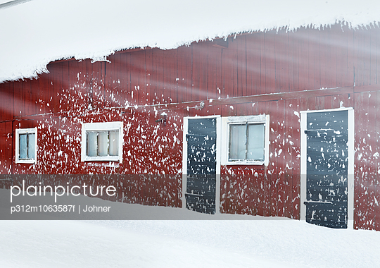 Wooden house at snowy weather