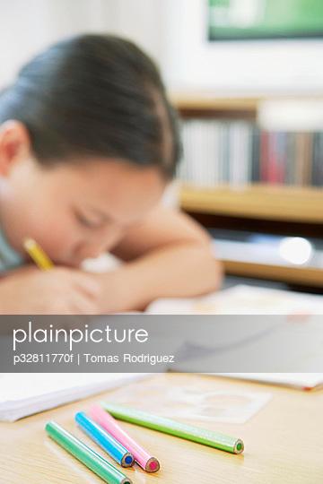 Girl using pencil