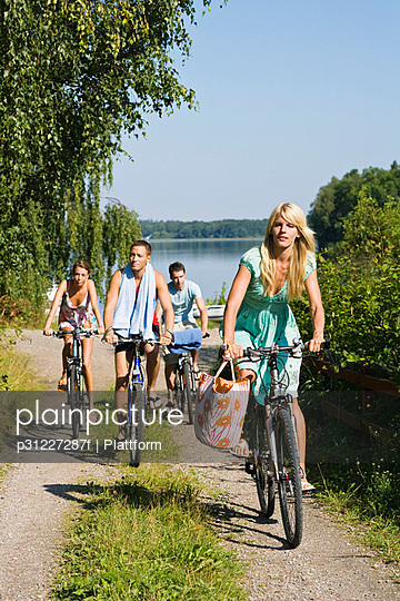 Four young people cycling