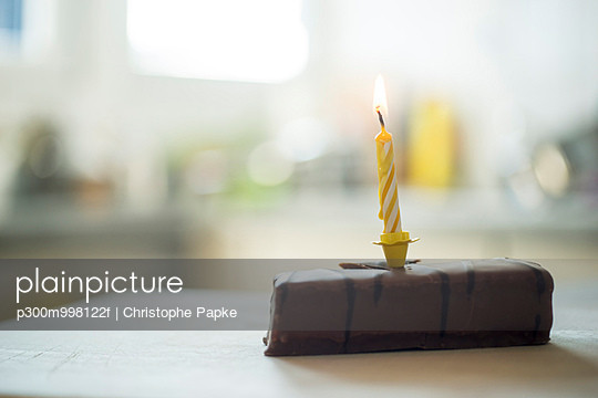 Birthday candle on chocolate cake