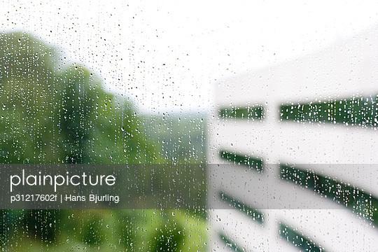 Rain on a window pane in an office Sweden.