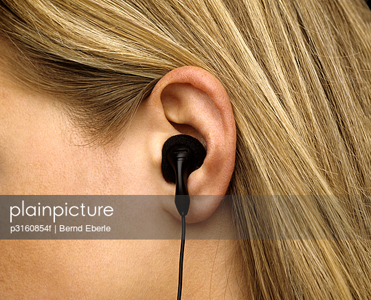 Close-up of ear with earphone