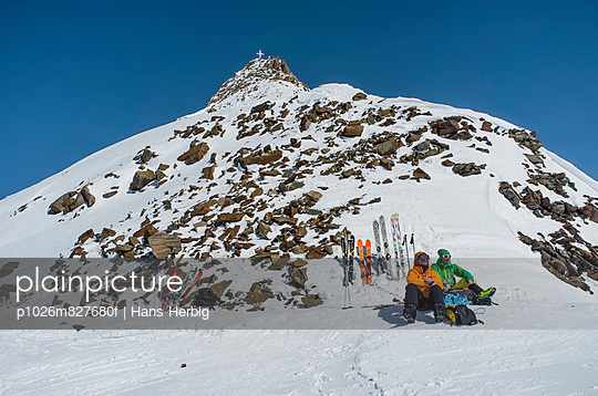 Back country skiers taking a rest, European Alps, Tyrol, Austria