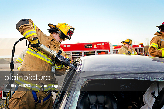 Fireman Using Jaws of Life to Break into a Car