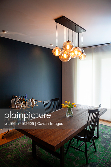 Illuminated Pendant Lights Over Dining Table At Home Stock Images Page Everypixel